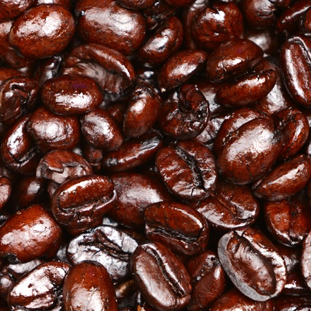french bean: Coffee beans closeup texture background. Dark french roast arabica coffee beans.