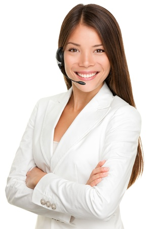 phone operator: Telemarketing headset woman from call center smiling happy talking in hands free headset device. Multicultural mixed race Chinese Asian  Caucasian business woman in suit isolated on white background. Stock Photo