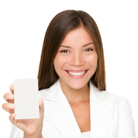 smart card: Sign card woman holding paper like mobile phone or smart phone. Empty paper business card with copy space. Beautiful young businesswoman smiling happy in white suit isolated on white background. Stock Photo