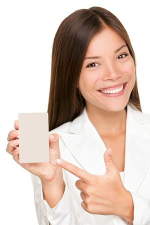 Woman showing holding small blank sign. Replace with smart phone, mobile phone or copy. Smiling happy young business woman. Mixed race Caucasian  Chinese Asian femal model isolated on white background. photo