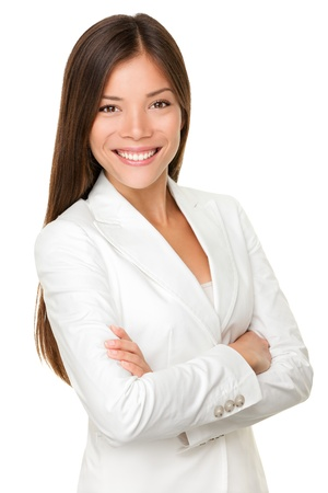 professionals: Asian business woman. Businesswoman portrait of smiling happy mixed race young professional in her twenties isolated on white background wearing white suit standing proud and content. Mixed Asian Chinese and Caucasian female model. Stock Photo