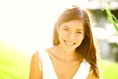 smiling sun: Summer girl portrait. Asian woman smiling happy on sunny summer or spring day outside in park by lake. Pretty mixed race Caucasian  Chinese Asian young woman outdoors. Stock Photo