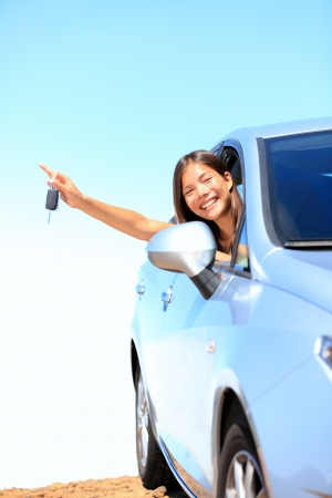 car keys: Car woman showing keys excited, happy and joyful  Young woman driver smiling in her new car  Mixed race Asian   Caucasian female model above the clouds on beautiful summer day