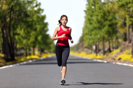 fitness model: Sport fitness running woman jogging during outdoor workout  Beautiful young female athlete runner training for marathon on forest road in spring or summer  Mixed race Caucasian   Chinese Asian woman fitness model  Stock Photo