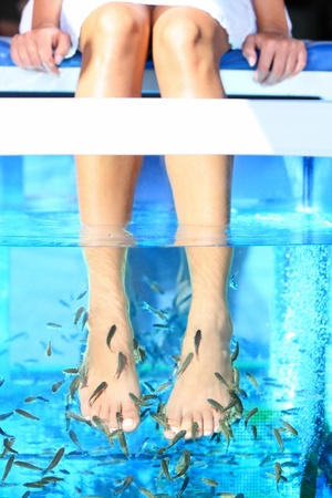 rufa: Fish Spa Rufa Garra pedicure treatment  Woman enjoying skin care fish spa beauty treatment  Stock Photo