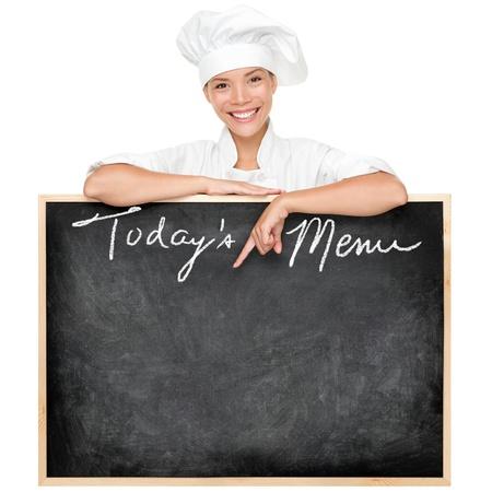 female chef: Menu sign. Restaurant chef showing menu blackboard sign written Todays Menu.
