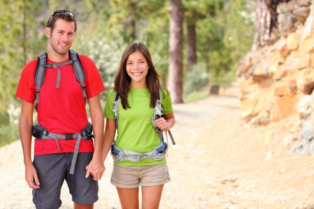 interracial relationships: Hiking. Hiker couple portrait. Stock Photo