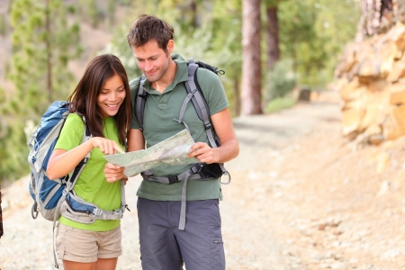hiking - hikers looking at map.  Stock Photo - 12720610