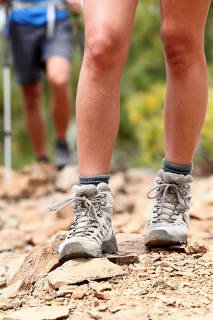 Hiker  Hiking shoes close up outdoors during hike - female shoes  Hikers in the background Stock Photo - 12903152