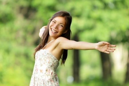happy: Free happy woman in spring park smiling joyful in summer dress. Freedom, happiness conceptual image with beautiful multiracial Caucasian  Chinese Asian girl with arms out.
