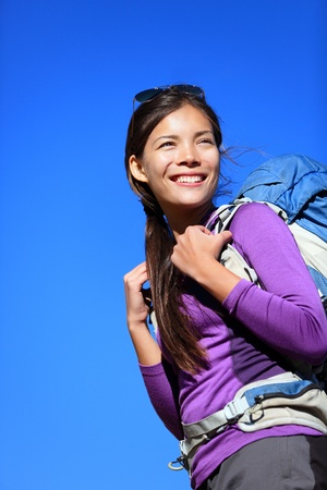 aspirational: Hiker portrait  Woman hiking outdoors smiling happy and aspirational  Beautiful young mixed race Caucasian   Asian female model during hike travel