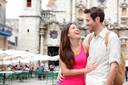 caribbeans: Tourists - happy couple in Cuba  Havana having fun during travel  Young interracial couple, Asian woman, Caucasian man, Plaza de la Catedral, Old Havana  Stock Photo