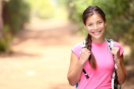 woman hiking: Hiker woman. Hiking portrait of happy young female hiker smiling looking at camera. Stock Photo