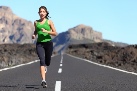 jogging in nature: Runner woman running on mountain road in beautiful nature  Asian female sport fitness model jogging training for marathon during outdoor workout  Stock Photo