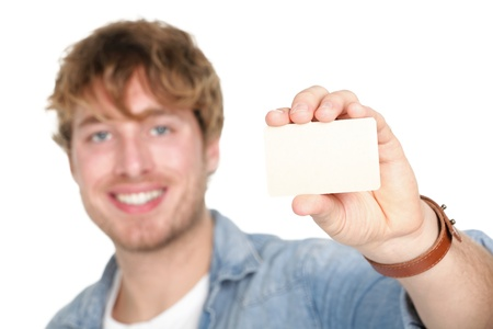 holding the head: Business card man. Casual young man showing blank empty card sign. Young caucasian male model in his twenties.