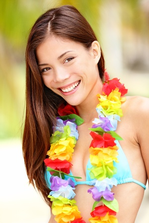 Summer vacation woman happy portrait closeup from tropical exotic beach  Beautiful mixed race Asian Chinese   Caucasian female model  photo