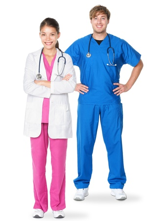 full uniform: Medical doctors standing isolated. Young caucasian man or young asian woman doctor professionals or nurses in medical scrubs isolated on white background. Stock Photo