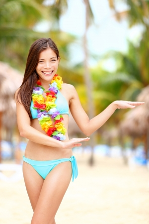 lei: Hawaiian dance - hula dancer vacation concept with beautiful mixed race Asian  Caucasian young woman dancing on tropical beach. Stock Photo