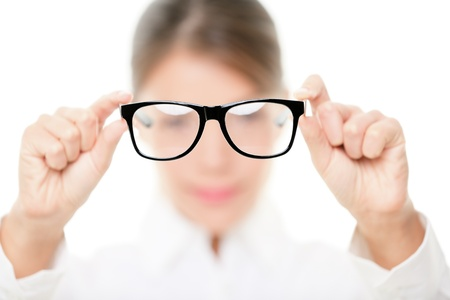 Glasses - optician showing eyewear  Closeup of glasses, with glasses and frame in focus  Woman optometrist on white background  photo