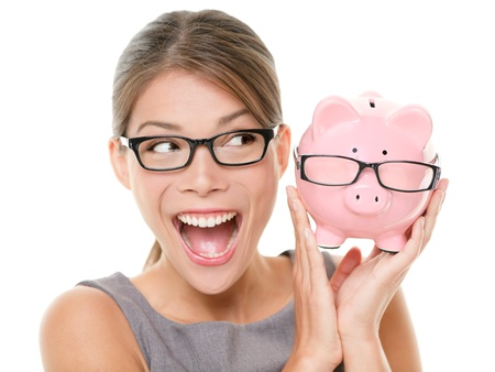 Save money on glasses eyewear Woman happy and excited over savings on buying eyewear glasses Piggybank and woman wearing glasses isolated on white background