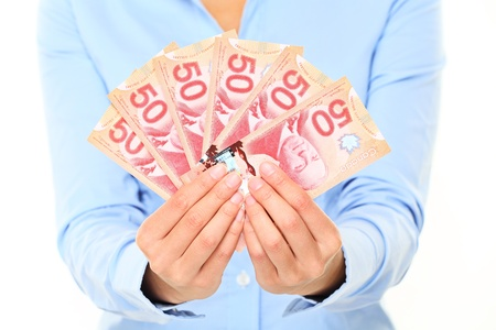 Canadian dollars money bills  50 dollars note Canadian dollar bills  Business woman holding canadian fifty dollars bills closeup  photo