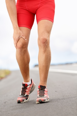 Knee pain - running sport injury  Male runner having knee problems during exercise outside  photo
