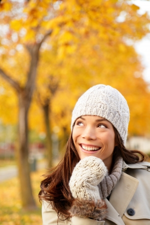 Fall woman thinking looking up in yellow autumn forest  Young happy smiling mixed race Caucasian and Chinese asian woman outdoors in city forest park Stock Photo - 14899632