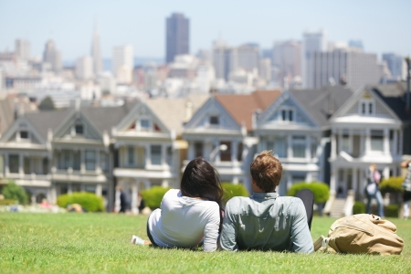 row house: San Francisco - Alamo Square people  Couple in Alamo Park by the Painted Ladies, The Seven Sisters, San Francisco, California, USA