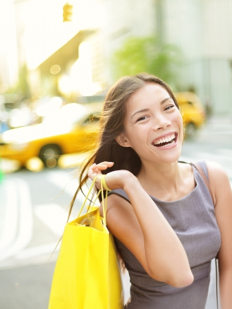 asian girl shopping: Shopping woman on Manhattan smiling happy and excited walking holding shopping bags Stock Photo