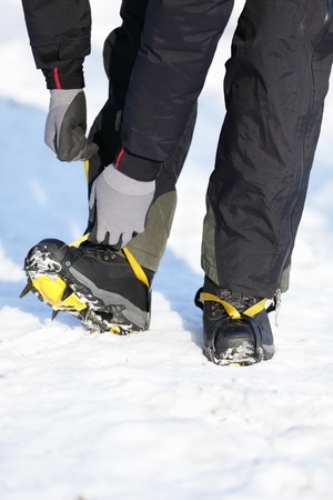 crampons: Crampons closeup. Crampons closeup. Crampon on winter boot for climbing, glacier walking or extreme hiking on ice and hard snow.