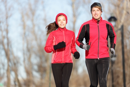 Young couple training outside in warm sport clothing outfit photo