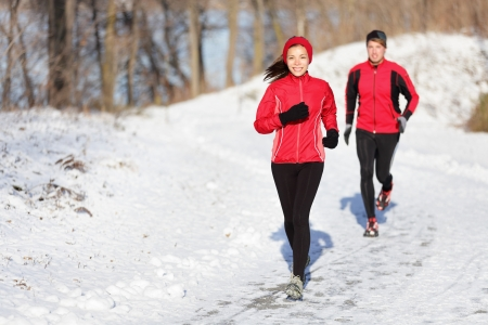jogging in park: Runners jogging in snow