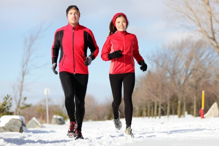 Male and female runner training for marathon photo