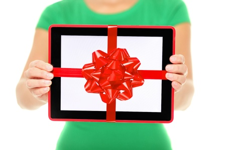 Tablet computer gift. Woman showing Digital touch screen tablet PC with gift ribbon. Closeup of woman giving tablet PC as christmas present. Stock Photo - 16467522