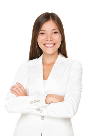 entrepeneur: Confident smiling young Asian businesswoman in a stylish white suit standing with her arms folded isolated on white Stock Photo
