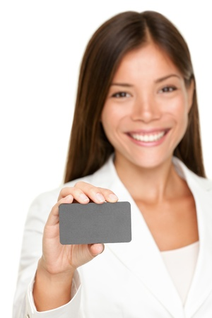 entrepeneur: Attractive business woman holding a blank gray card