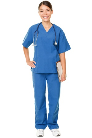 asian doctor: Young doctor. Studio shot over white of a young Asian female doctor, wearing blue scrubs and with a stethoscope draped around her neck Stock Photo