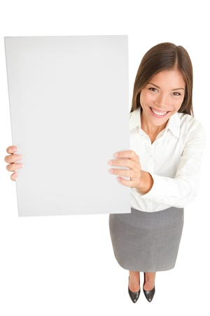 Businesswoman banner. High angle full length portrait of a beautiful smiling Asian businesswoman holding up a blank sign with copyspace for your text or advertisement isolated on white background. Stock Photo - 16684469