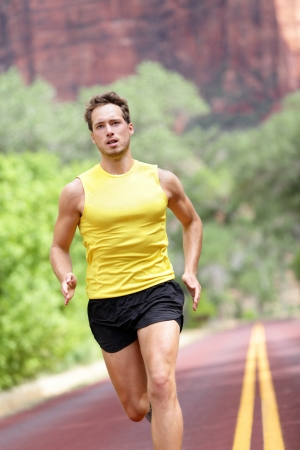 men running: Sport - running fitness man sprinting training for marathon run  Fitness man with determination, concentration and strength training towards goals and success