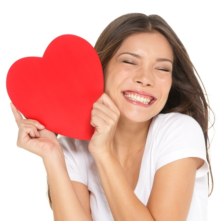adult valentine: Love and valentines day woman holding heart smiling cute and adorable isolated on white background  Beautiful ethnic asian woman in love