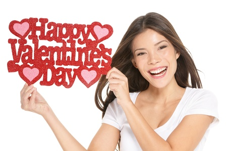Valentines day  Woman showing holding sign excited with the text VALENTINES DAY   Lovely happy multiracial Caucasian   Asian Chinese young woman isolated and cut out on white background in studio  photo