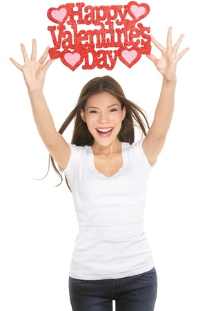 elated: Woman showing Valentines day sign smiling happy, excited and elated  Ethnic Caucasian   Asian Chinese young woman isolated and cut out on white background in studio