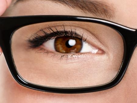mascara: Glasses eyewear closeup. Macro of woman black eye wear glasses frame. Brown eyes of multiethnic Chinese Asian  Caucasian woman model.