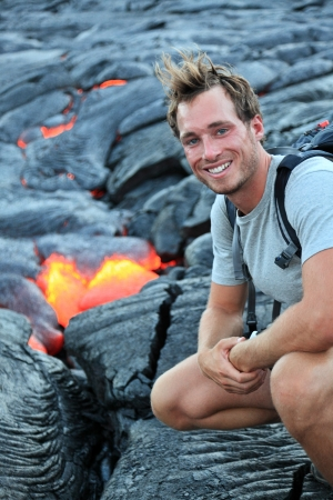 Hawaii: Hiker seeing lava from Kilauea volcano around Hawaii volcanoes national park, USA. Young caucasian man hiking. photo
