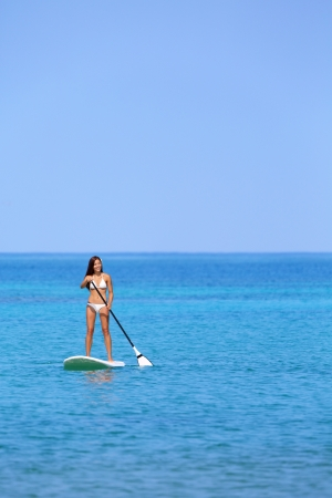 Hawaii beach lifestyle woman paddleboarding in bikini   photo