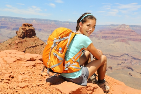 kaibab trail: Grand Canyon hiker woman resting portrait  Hiking multiethnic girl relaxing on South Kaibab Trail, south rim of Grand Canyon, Arizona, USA