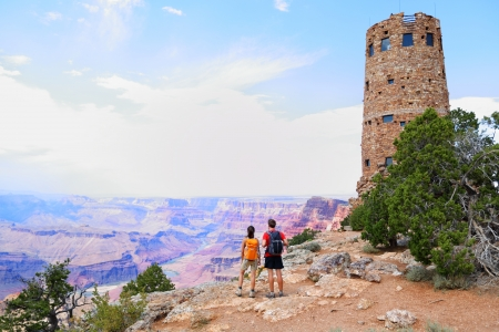 Grand Canyon people hiking  Hiker couple enoying view  Indian Desert View Watchtower, south rim of Grand Canyon, Arizona, USA
