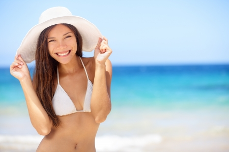 caribbeans: Beach vacation woman in sun smiling happy on summer holidays on tropical beach