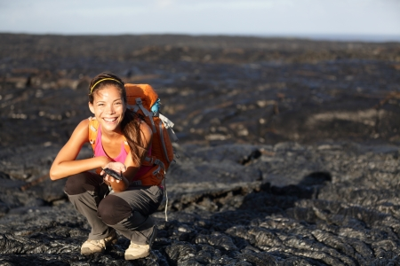 cooled: Hiker showing fresh cooled lava from Kilauea volcano around Hawaii volcanoes national park, Big Island, Hawaii, USA