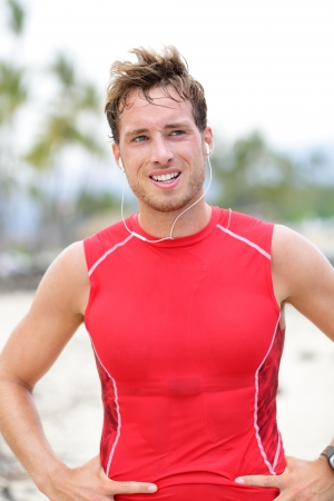 joggers: Athlete runner man sweating after running on beach=